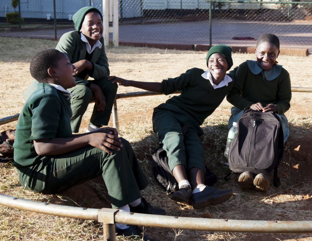 This image has an empty alt attribute; its file name is Dzikwa-kids-in-yard-1-1024x791.jpg